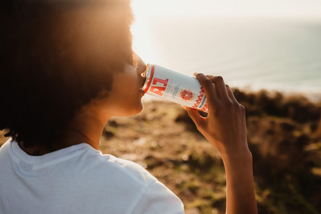 Woman drinking A1 Fruit Water